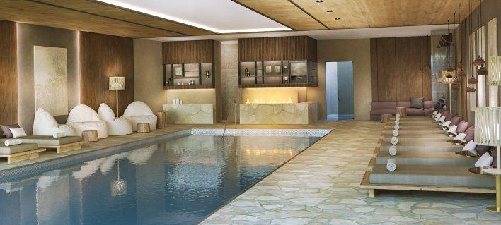 Salle de bien-être avec fauteuils de détente, poufs et piscine chauffée